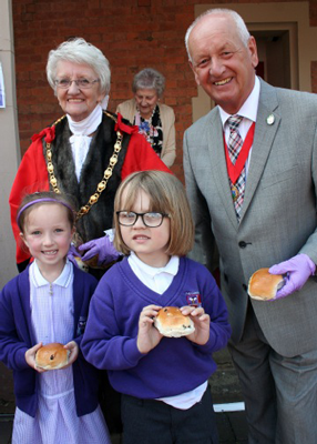 Mayor and deputy with pupils